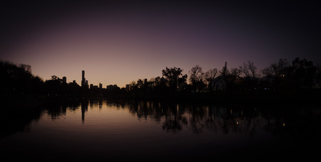 dusk with melbourne city reflected in the yarra river