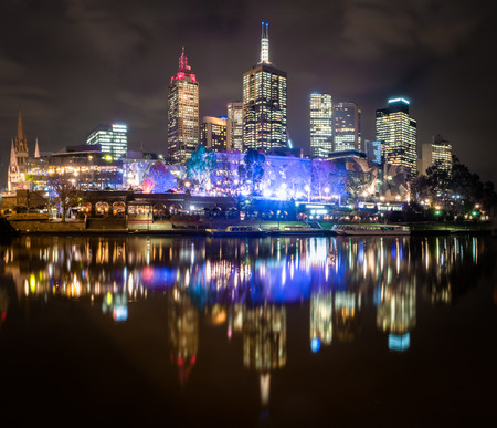 Colorful Melbourne on a cold winters night reflected in the Yarra river Stock Photo