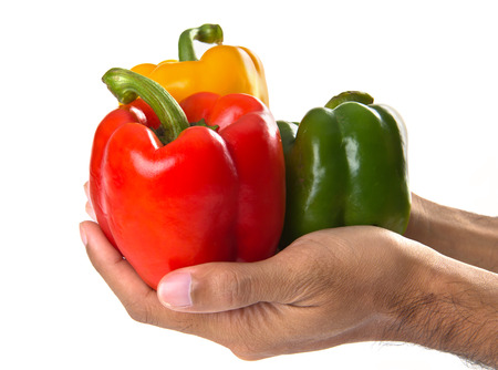 Three color peppers on the hands photo