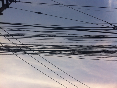 wire: Wire unkempt on electricity post Stock Photo