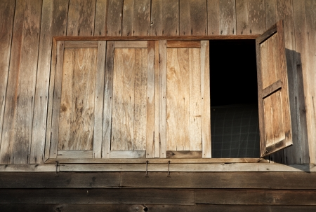 Wooden Windows of Old House in Thailand photo