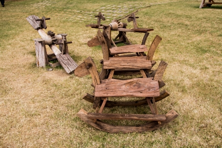 Wooden rocking horse and seesaw photo