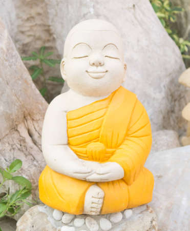 Stone sculpture of young monk for the garden Stock Photo