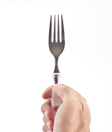 Fork in right hand isolated on white background