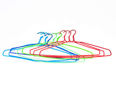 Colorful hangers on white background Stock Photo