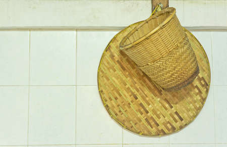 Kitchenware from Bamboo for cooking on the white wall