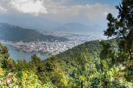 Pokhara town and Phewa Lake as seen on the way up to the World Peace Pagoda. Taken in Nepal, Dec 2018