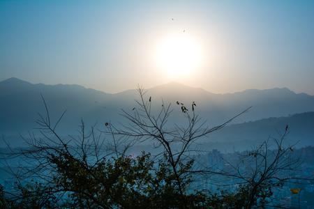 The romantic sunset view from Swayambhunath Stupa of Kathmandu. Taken in Nepal, January 2019. Banco de Imagens