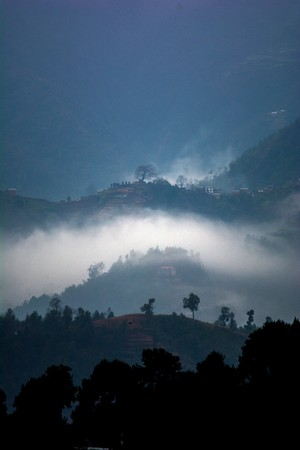Winter fire smoke in a small remote hilly village of Nepal