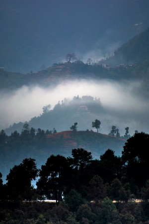 Winter fire smoke in a small remote hilly village of Nepal Reklamní fotografie - 116770384