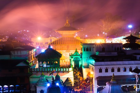 Hindu temple Pashupatinath at night light, Votive temples and shrines in a row at Pashupatinath Temple Kathmandu Nepal.