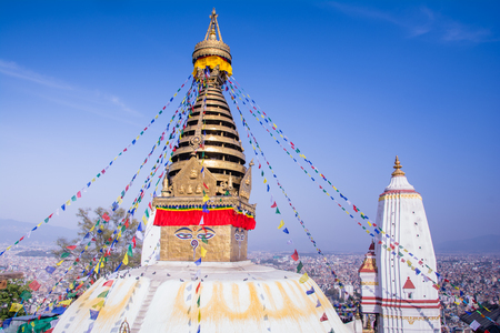 Swayambhunath or Monkey temple is an ancient religious architecture atop a hill in the Kathmandu Valley with a clear blue sky from Swayambhu, west of Kathmandu City, Nepal , March 2019 Stockfoto