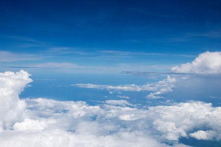nebulosity: blue  sky  viewed from an airplane window