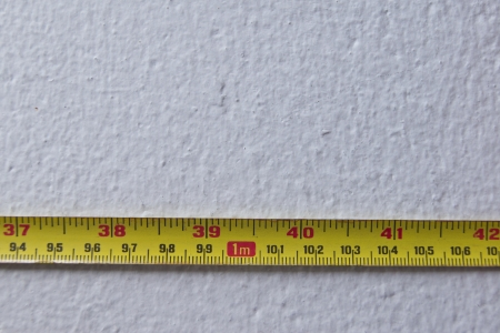 yellow measure tape on wall photo