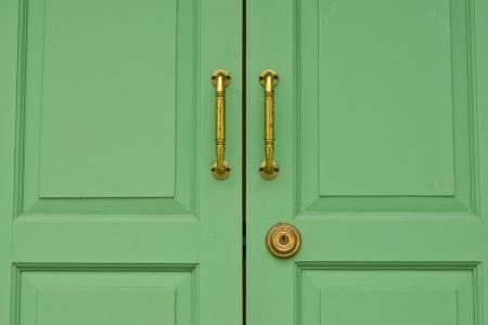 Green door ,wood door , lock , home photo