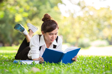 Asian student in park of Bangkok Thailand