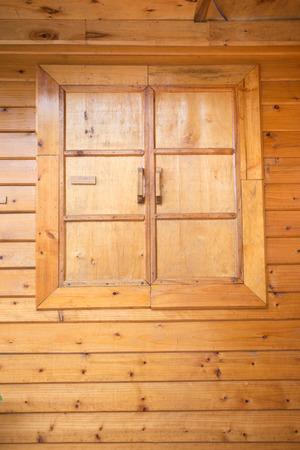 wood window on the home wall photo
