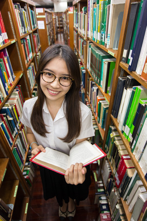 junior student: Asian student student discuss in library of university