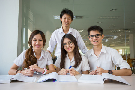 1 and group: Asian student student discuss in library of university