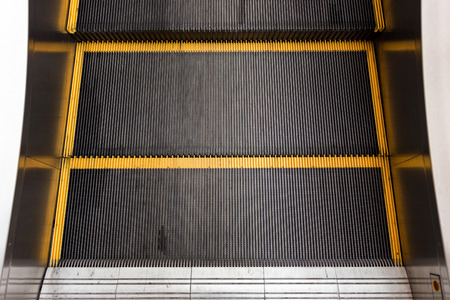 yellow line: black escalator with yellow line on step