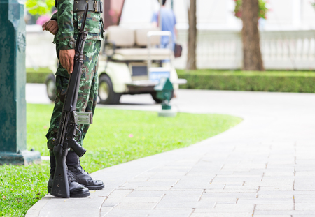 power rangers: Gun and soldier ,who stand during his work Stock Photo