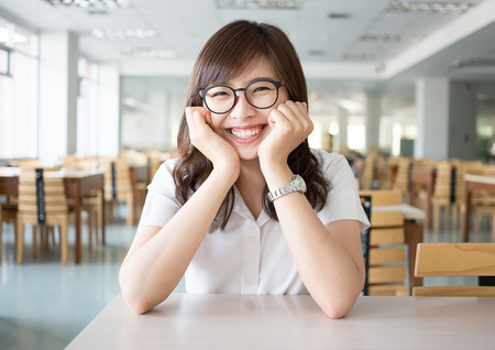 olds: Asian student in library of university Stock Photo
