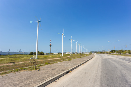 electric avenue: big turbine, which generate electricity for industry, along the road in Thailand