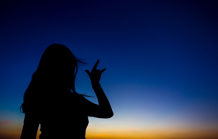 silhouette  female with emotion in sunset time