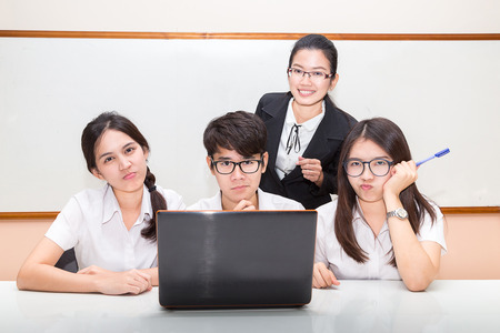 20 24 years: Asian student and teacher in classroom Stock Photo
