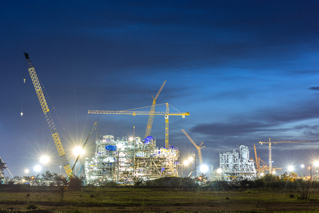 construction plant: construction of chemical plant industry  in sunset time