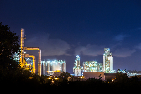 downstream: oil refinery and petrochemical plant with cooling tower in twilight time in south east asia