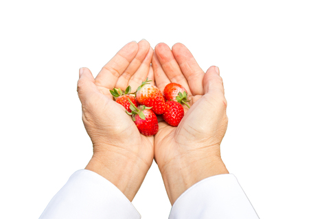 strawberry in female hand with isolate background