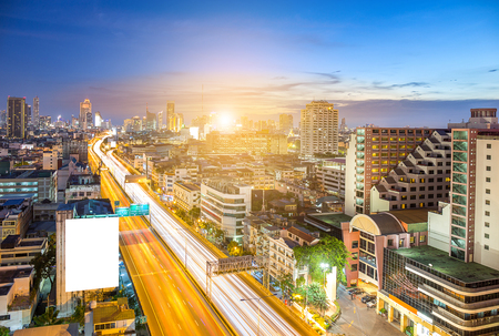Highway and skyling with white billboard in business zone or downtown of Bangkok Thailand in twilight time, sunset Stock Photo