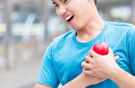heart disease accident with sport man, who has good health, in downtown of business