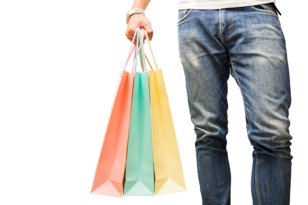 man wear jean and hold colorful shopping bag in hand on isolated background