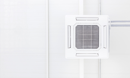 Ceiling and clean air condition is installed with copy space of white background and design of piping system which is connection of air system, climate technology for cool temperature in home, office