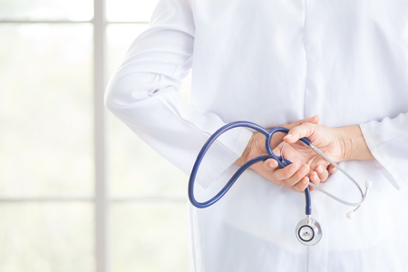 Doctor hold stethoscope in hand technology for diagnose disease for patient for cure and have a good health copy space of hospital or clinic background