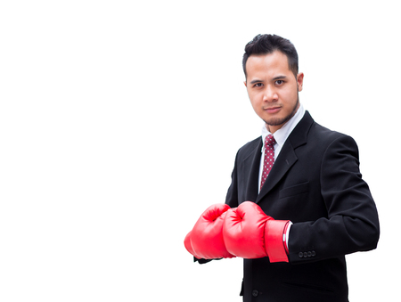 Smart business man wear boxing glove on isolate background, white, with confidence and success motion in a concept of business, sport, and healthy