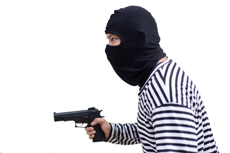 thief or murder hold pistol gun and look at the target for the money on isolate white background in a concept of life, thief, money, safe