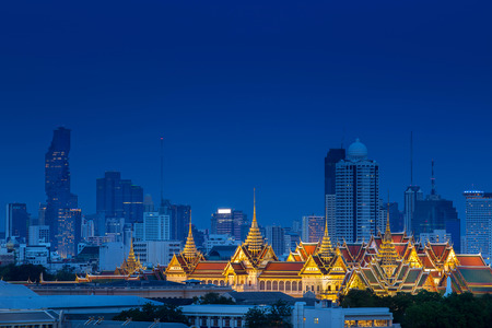 Aerial view of Royal Grand Palace on Bangkok, Thailand with luxury skyline, and condo in downtown at night after sunset time, where is the most famous landmark for travel, landscape and cityscape
