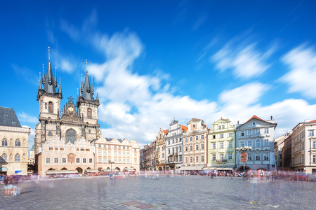 Prague old town square with old church and castle in shopping street where is the famous landmark for tourist in Prague, Czech Republic, Europe. With smooth motion blur of tourist on main square or sh