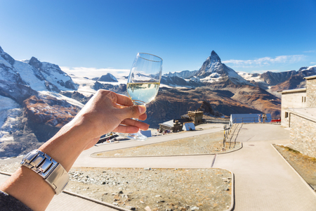 Champagne or wine for celebration with amazing view of Matterhor 스톡 콘텐츠