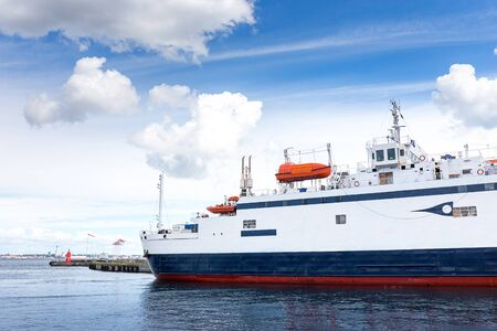 Modern and luxury ferry boat at harbor for across the sea from Helsingor north of Copenhagen, Denmark to Helsingbor, Sweden with blue sky and cloud Archivio Fotografico