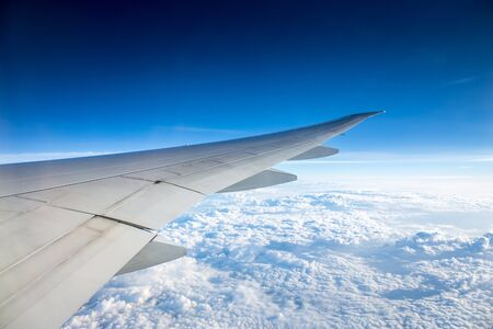 Aerial, or top view of amazing clear blue sky and cloud after sunrise and takeoff from airport from window view of airplane with airplane view during air transportation from Asia to Europe Archivio Fotografico