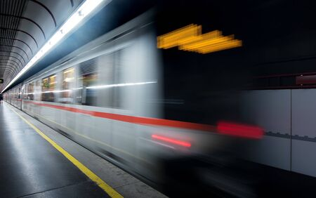 moving light trail of train in subway and passenger at platform for transportation in business city of Europe