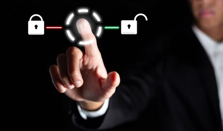 businessman touch on graphic for icon with fingerprint to unlock the key in office to scan for access and authorization connect online social business and network in office with technology concept