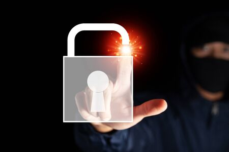 malware internet hacker thief unlock key concept on black background in concept of digital wallet money warning for computer data security or virus and cyber warning for internet and online criminal Archivio Fotografico