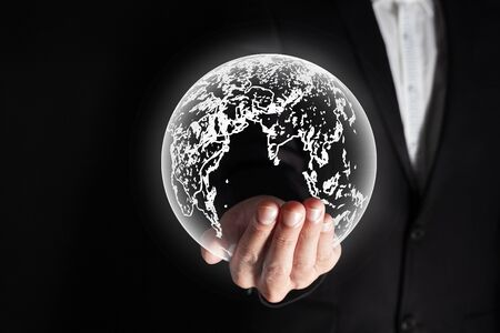 successful new generation of future businessman hold and carry light effect earth on hand in concept of business and future technology on black background