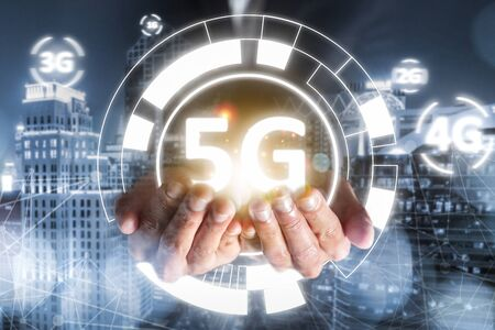 success businessman hold 5G technology evolution 4G, 3G, 2G, 1G, connection online network with high speed cyber access digital wireless for people communication business with cityscape view Archivio Fotografico