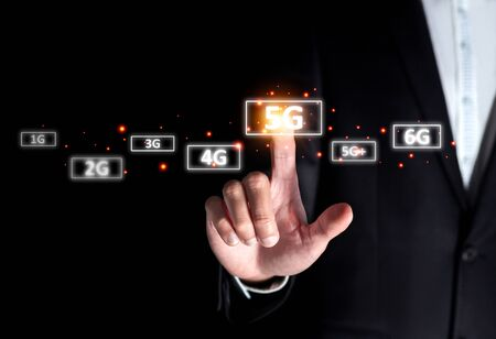 success businessman select on 5g high speed instead of 4g connect to internet online digital technology on smart broadband LTE signal computer device and future technology concept